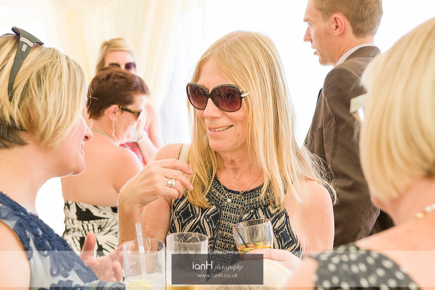 Smiling guests at Bournemouth beach wedding
