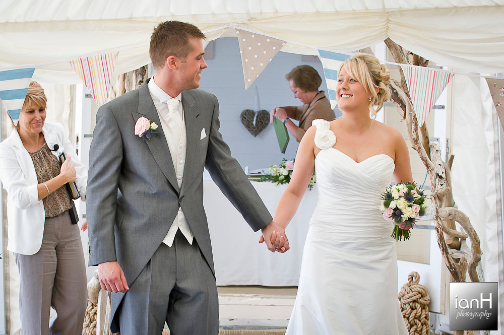 bride-and-groom-walk-down-the-aisle-at-their-beach-weddings-bournemouth-ceremony