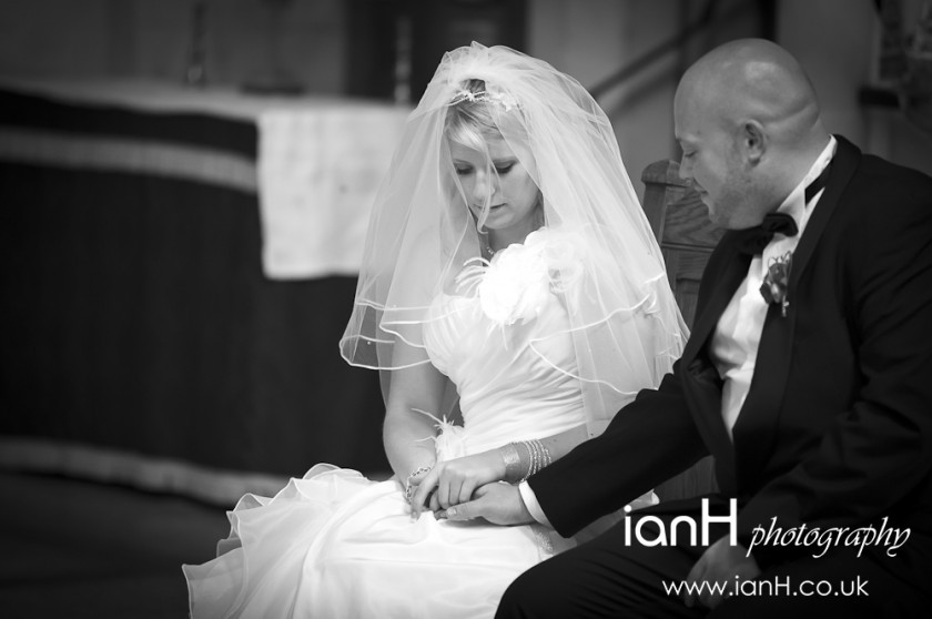 Bride_and_groom_holding_hands_in_Bournemouth_Church_by_Bournemouth_and_Dorset_wedding_photographer