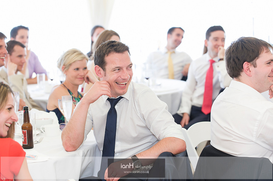Laughter at beach wedding reception