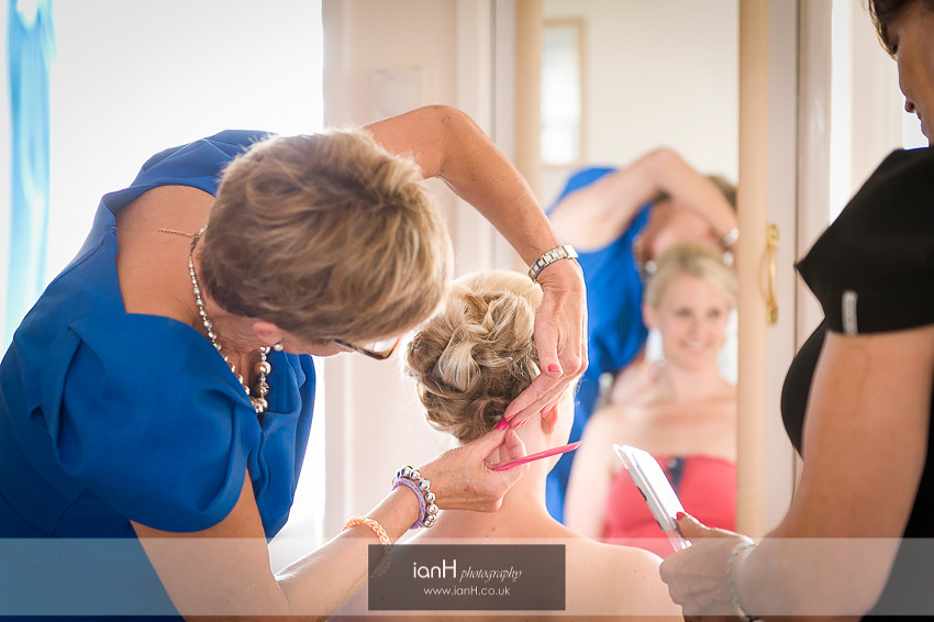 Bridal hair being adjusted during the wedding preparations