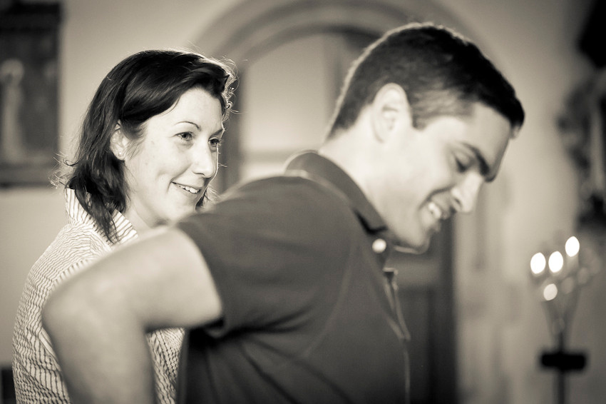 Bride smiling at her future groom in the wedding rehearsal at the Church of the Sacred Heart in Bournemouth
