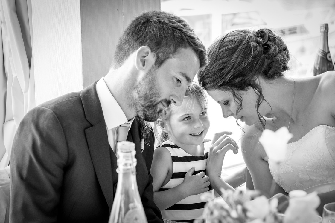 Bride and Groom with a little girl