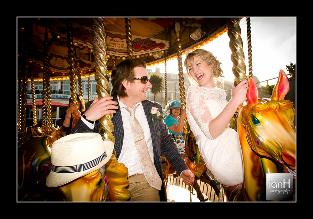 fun-on-the-carousel-for-bride-and-groom-after-bournemouth-beach-wedding