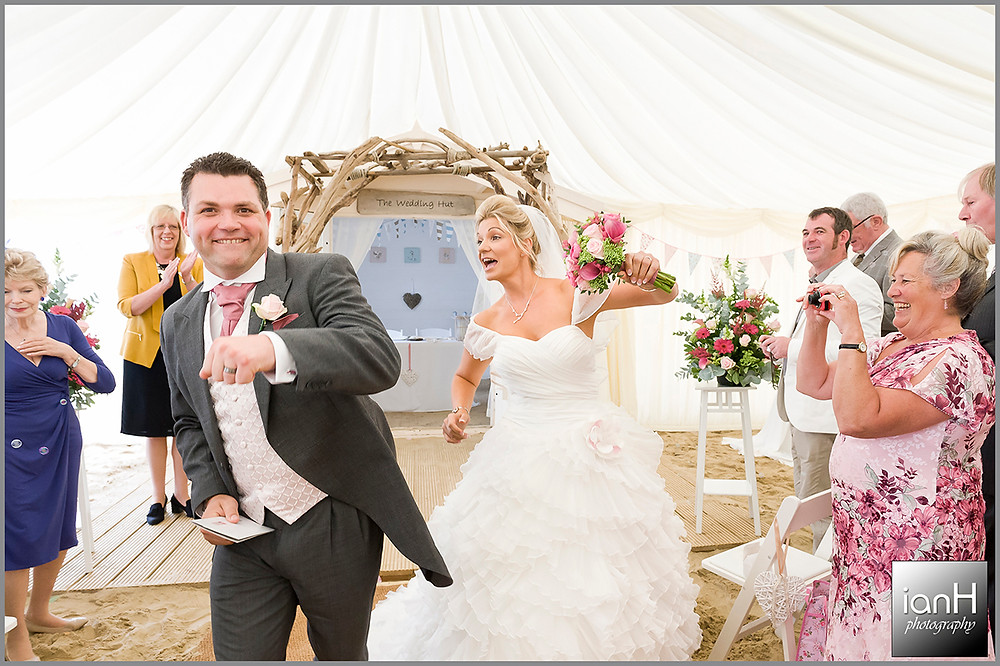 Bride and Groom dance down the asile at Beach Weddings Bournemouth