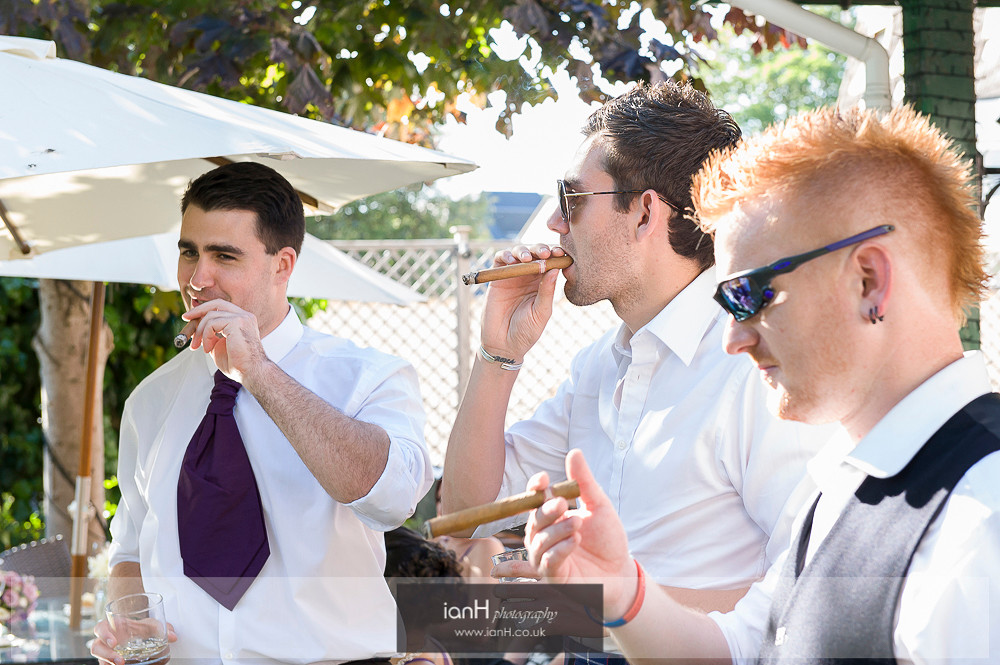 Ushers with cigars at Bournemouth wedding