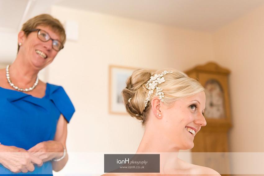 Bride admiring her wedding hair