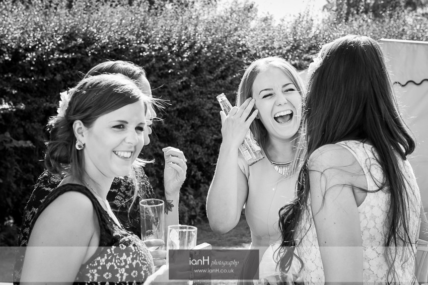Laughing guests at Hampshire country wedding
