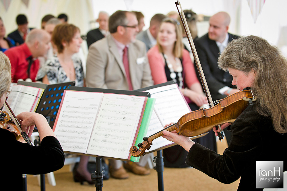 string-quartet-playing-as-couple-sign-the-register-bournemouth-beach-wedding