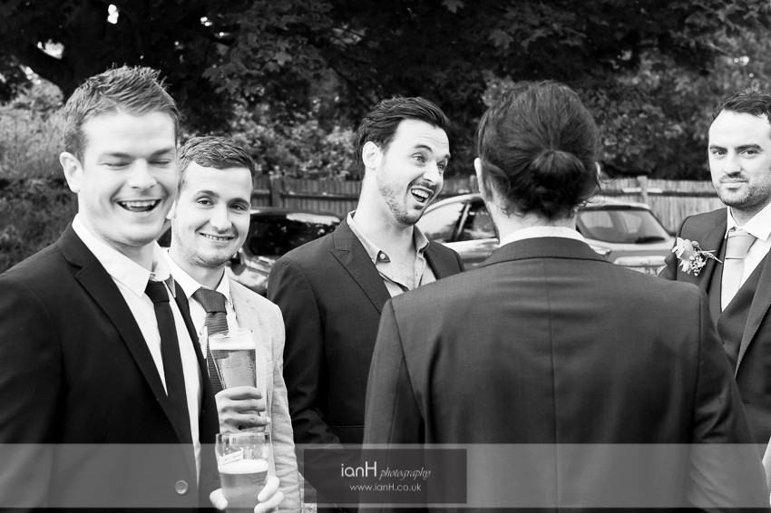 Guests laughing before a Hampshire wedding