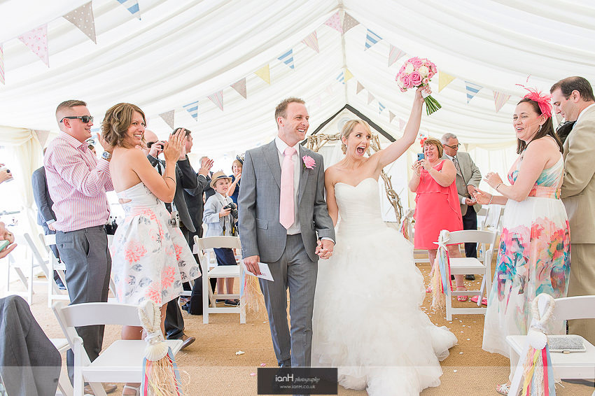 Bride and Groom in aisle at Beach Weddings Bournemouth