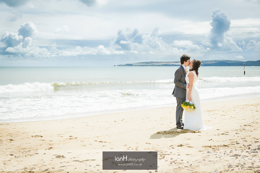 Bride and Groom kiss on the beach