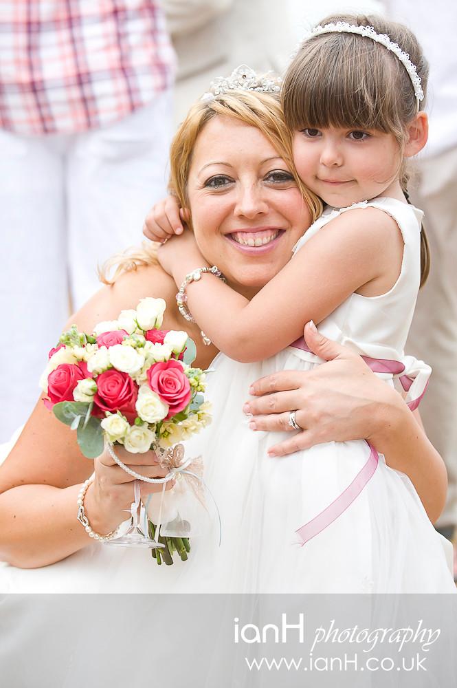 Happy_Bride_with_flowergirl_at_Bournemouth_beach_wedding