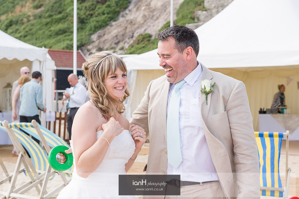 Laughing couple at beach wedding
