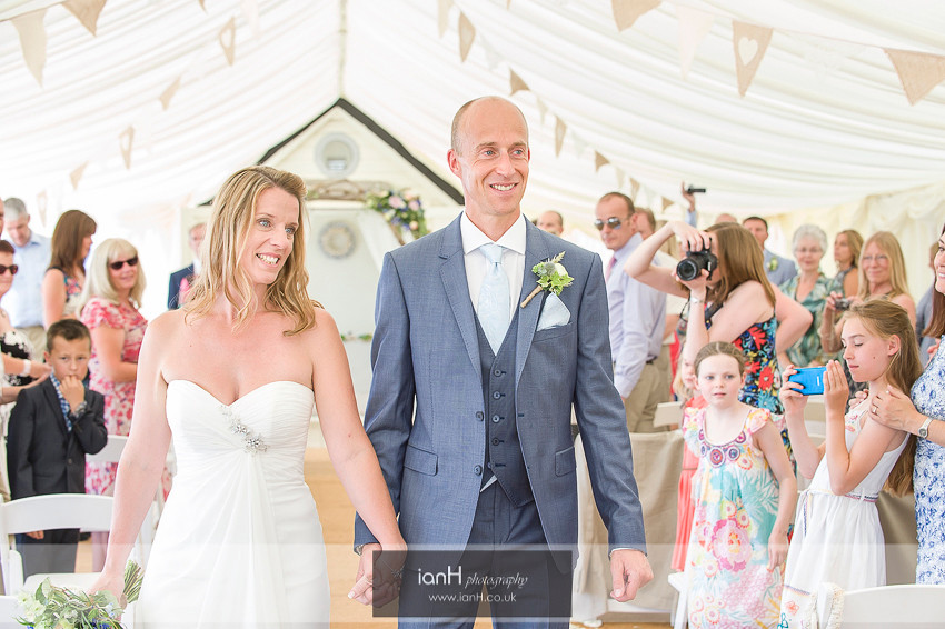 Bride and Groom walk down aisle at Beach Weddings Bournemouth