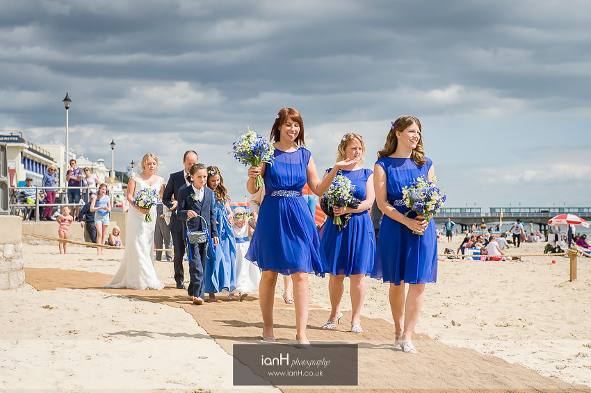 Bridal party walking on Bournemouth beach