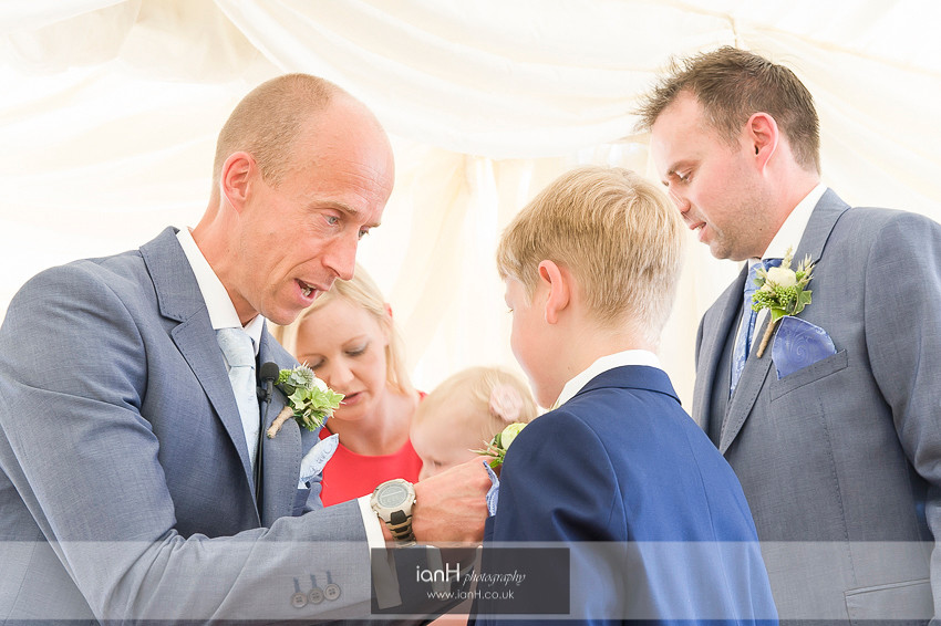 Groom adjusting buttonholes at Beach Weddings Bournemouth