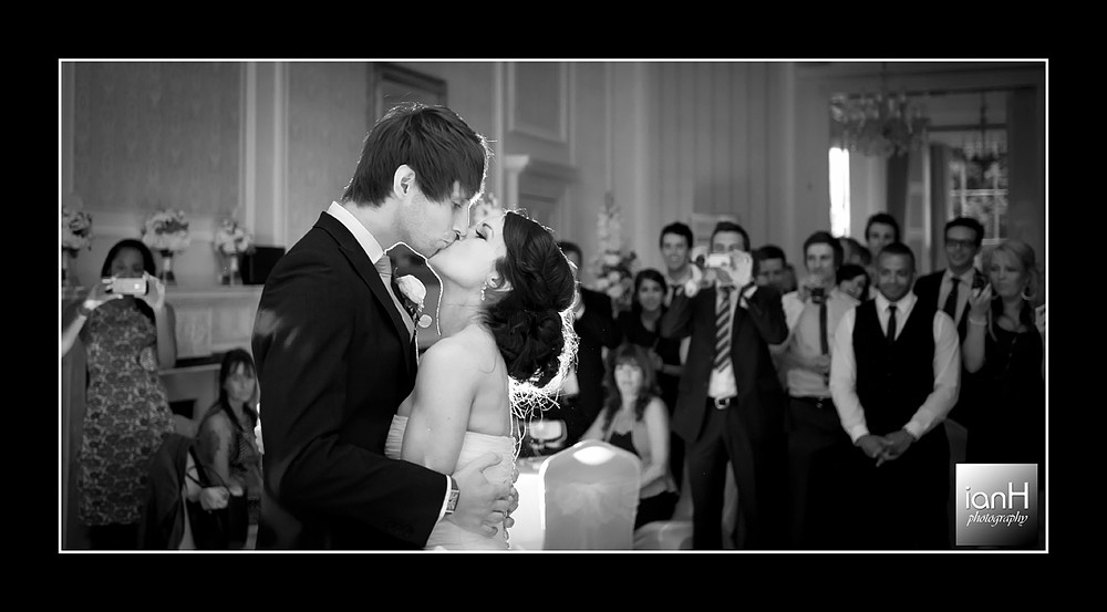 The First Dance and a kiss for the Bride and Groom at their Merley House wedding