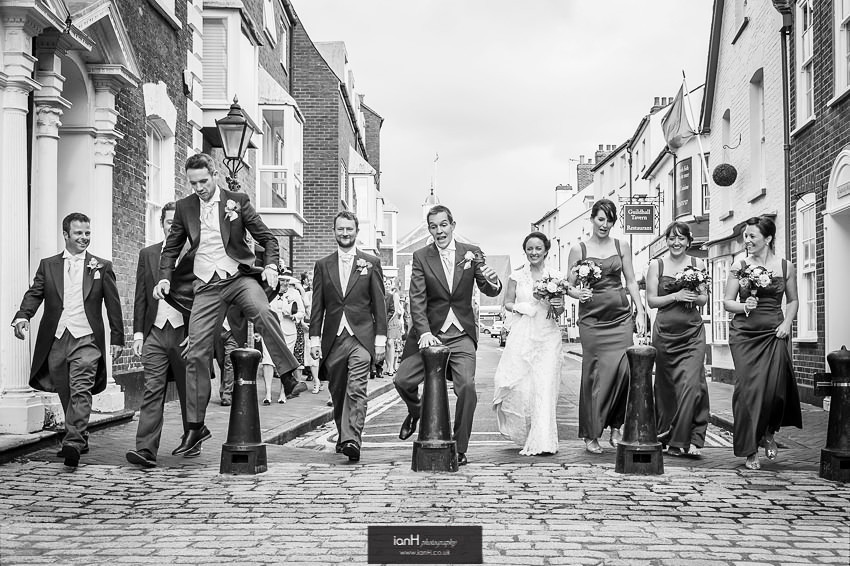 Leaping Groom and Ushers at Poole Guildhall wedding