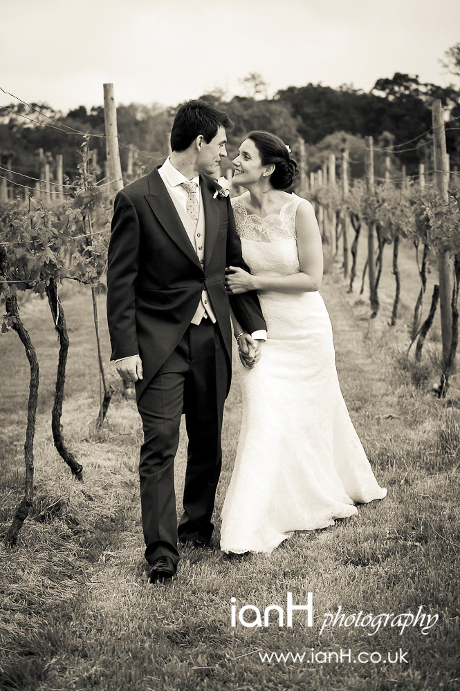 Bride_and_Groom_stroll_through_a_New_Forest_vineyard_after_their_Hampshire_wedding_photographed_by_Hampshire_wedding_photographer