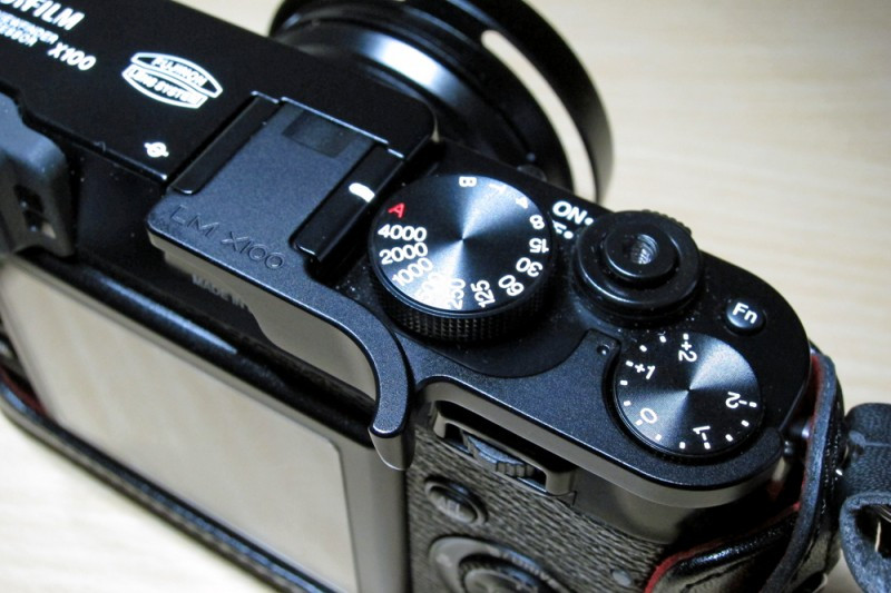 Photo showing the Lensmate grip for the Fuji X100 attached to the camera hot-shoe by Dorset wedding photographer