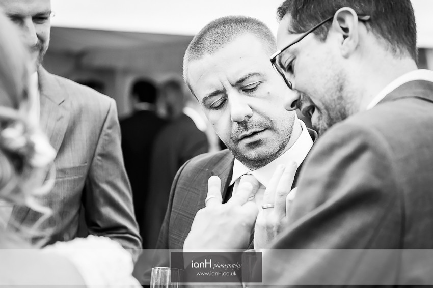 Groom and Best Man compare wedding rings