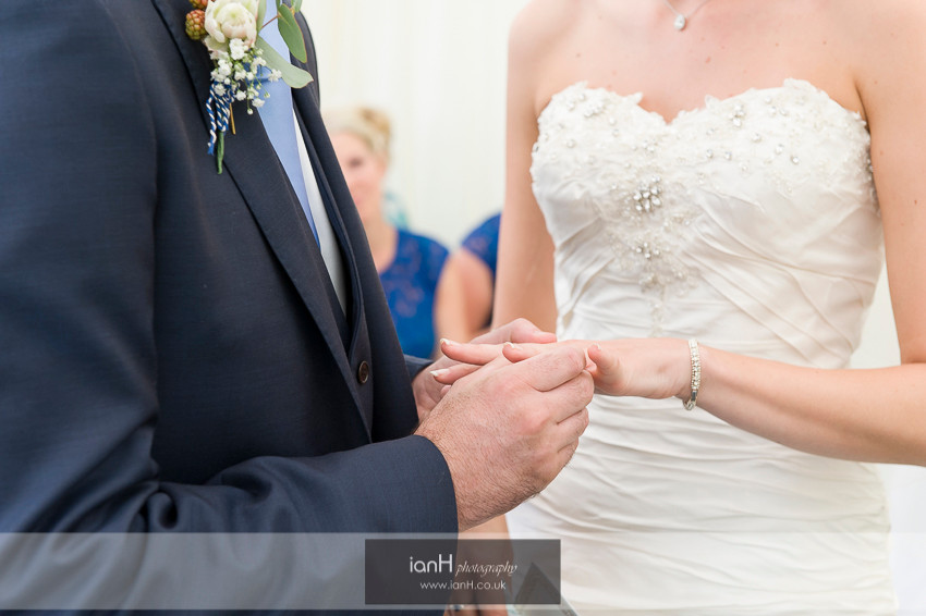 Groom placing the ring on his Bride's finger at a Hampshire wedding
