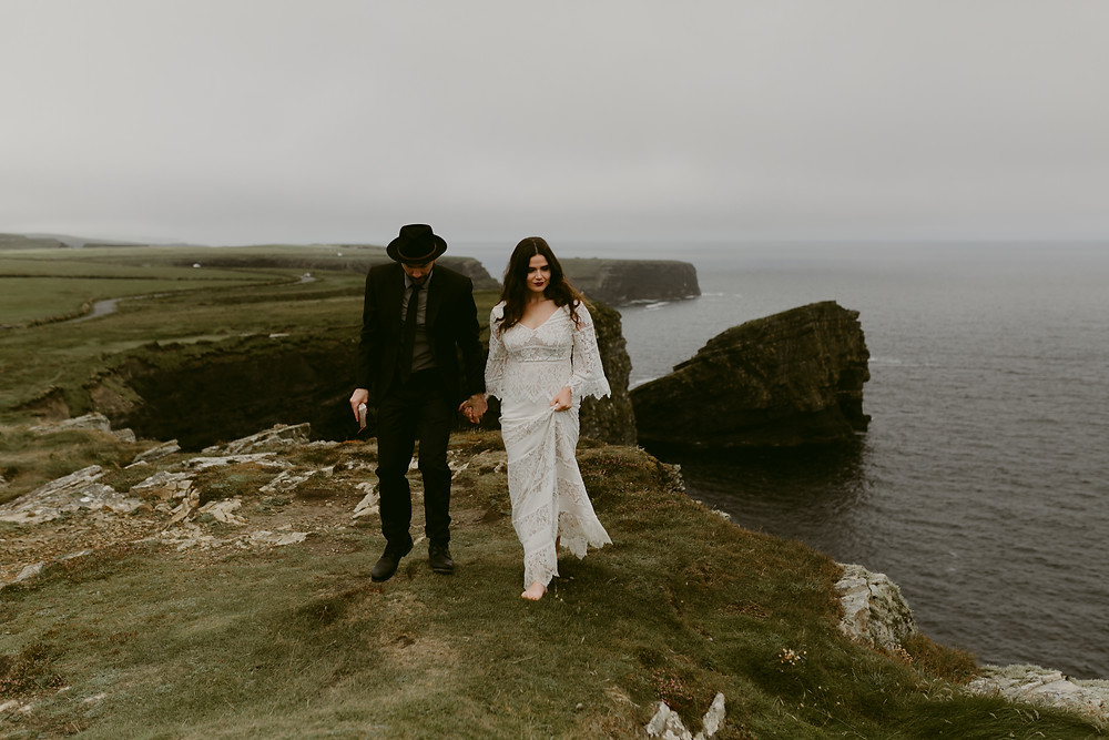Destination Pre wedding Photoshoot: Couple on the edge of a cliff
