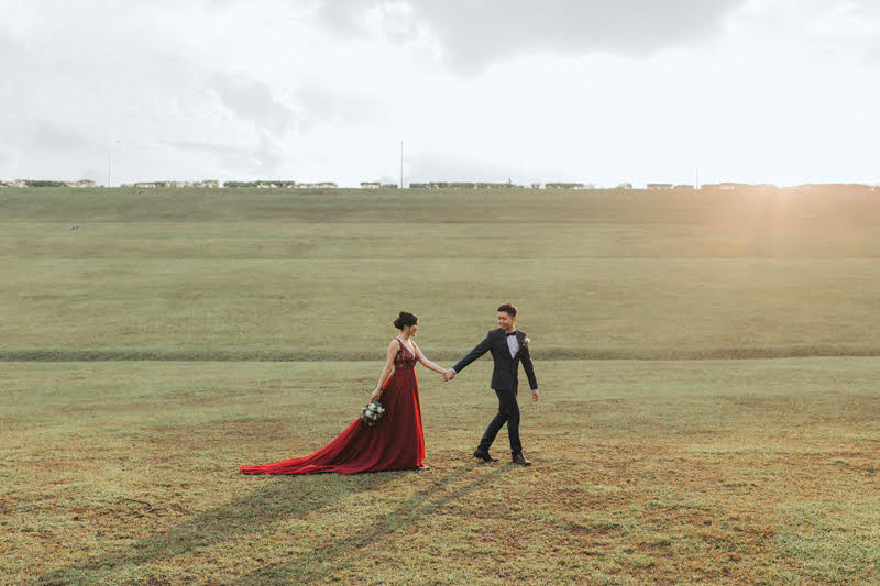 Pre Wedding Photography: Groom leading Bride across a field