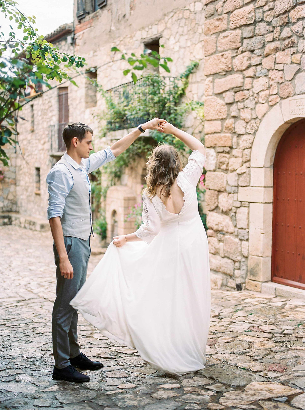 bride and groom twirling pose pre wedding shoot
