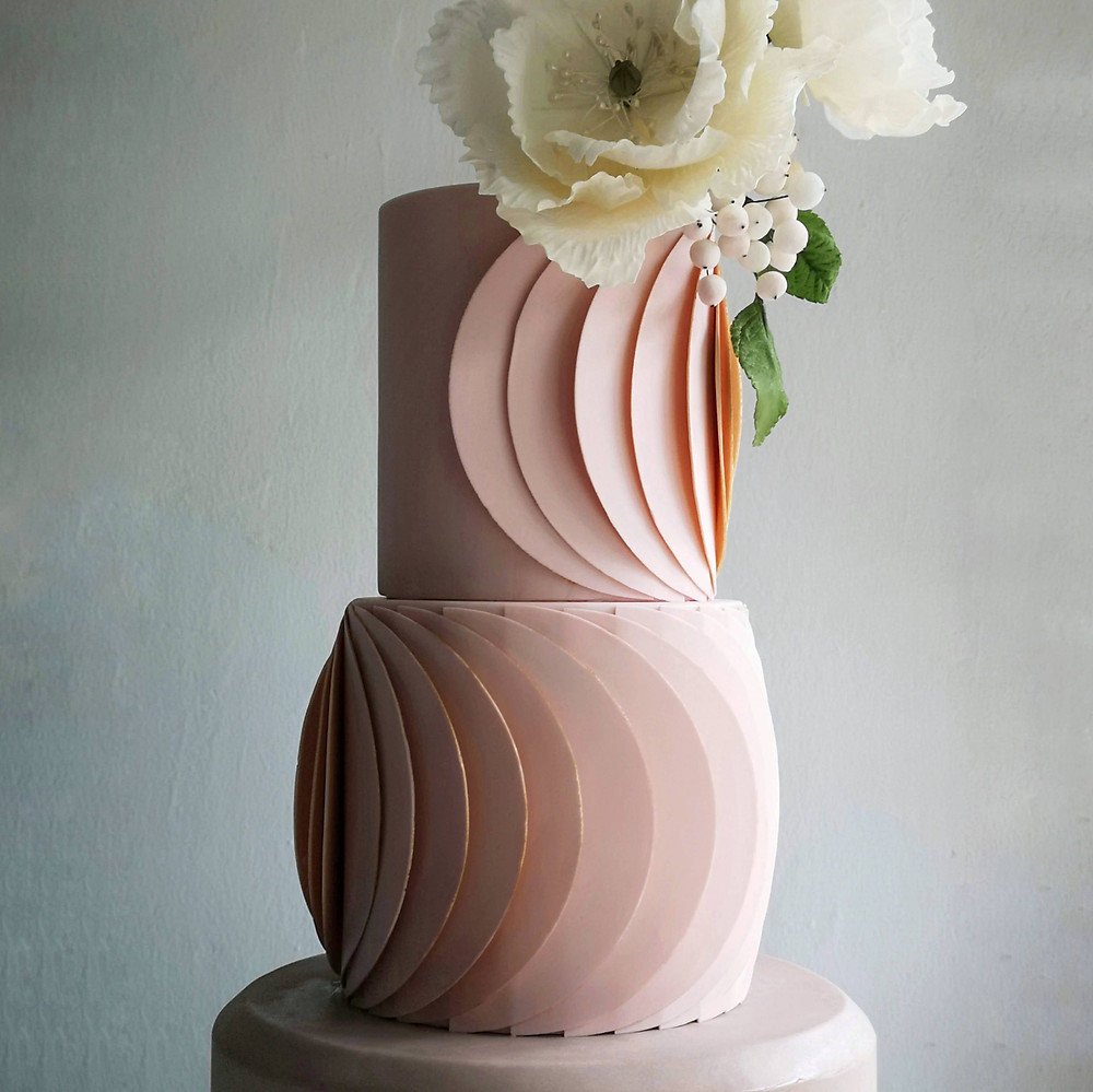 Structured 3 Tier Pink Wedding Cake with Large Flower on top