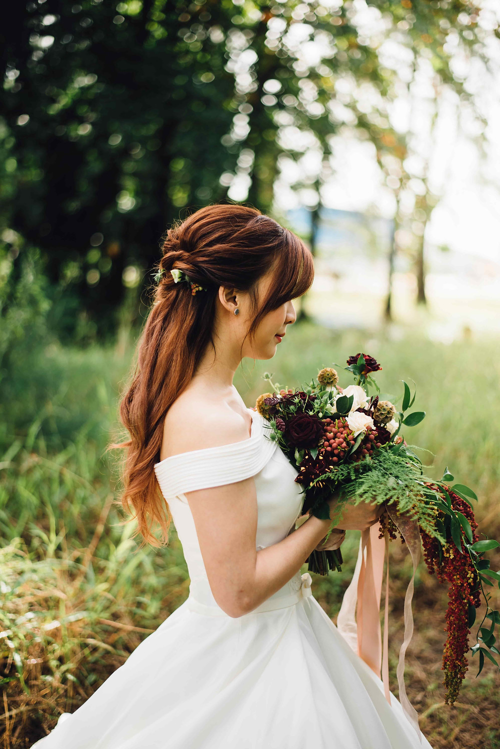 Bride with Long Hair Holding Bouquet in a Backfacing Wedding Shoot Pose