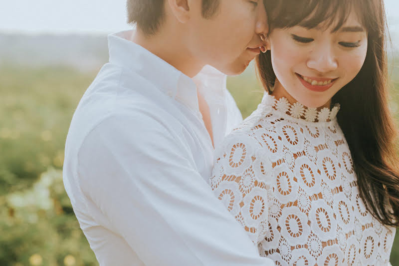 Pre Wedding Photography: Guy embracing girl from back