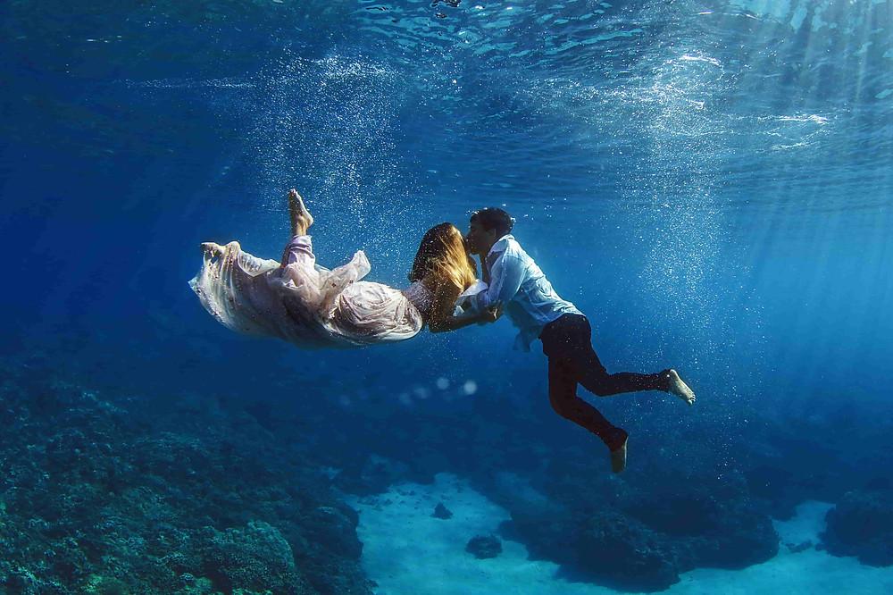 Pre Wedding Photoshoot: Couple in embrace underwater in open seas