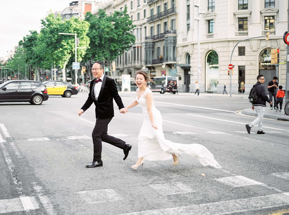 bride and groom running across road
