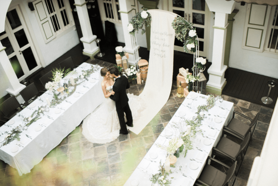 Singapore Wedding Venue: Wedding Set up with Couple in the central yard of Senso Ristorante