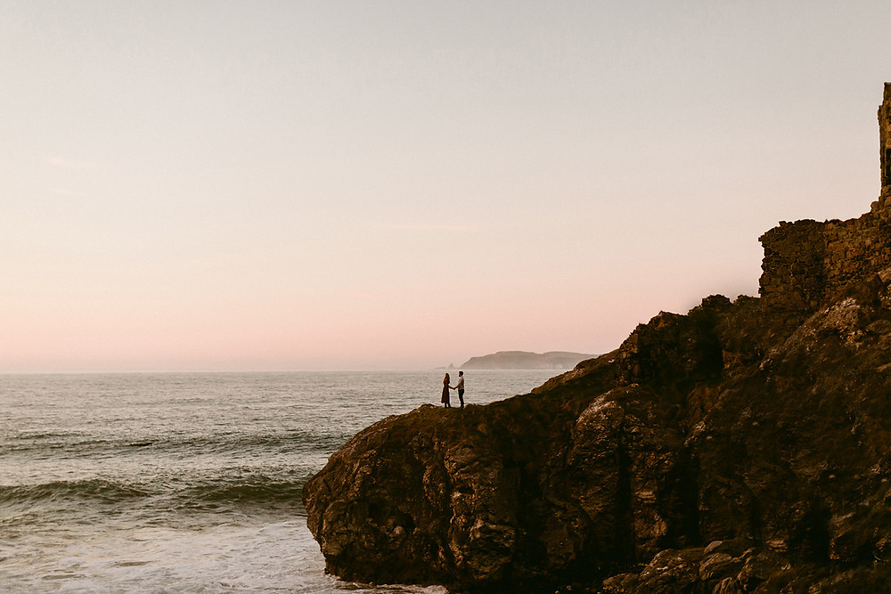 Destination Pre wedding Photoshoot: Couple on the cliff overlooking the sea