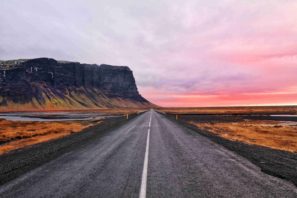 Wedding photoshoot destination: Empty stretch of road and beautiful pink icelandic skies