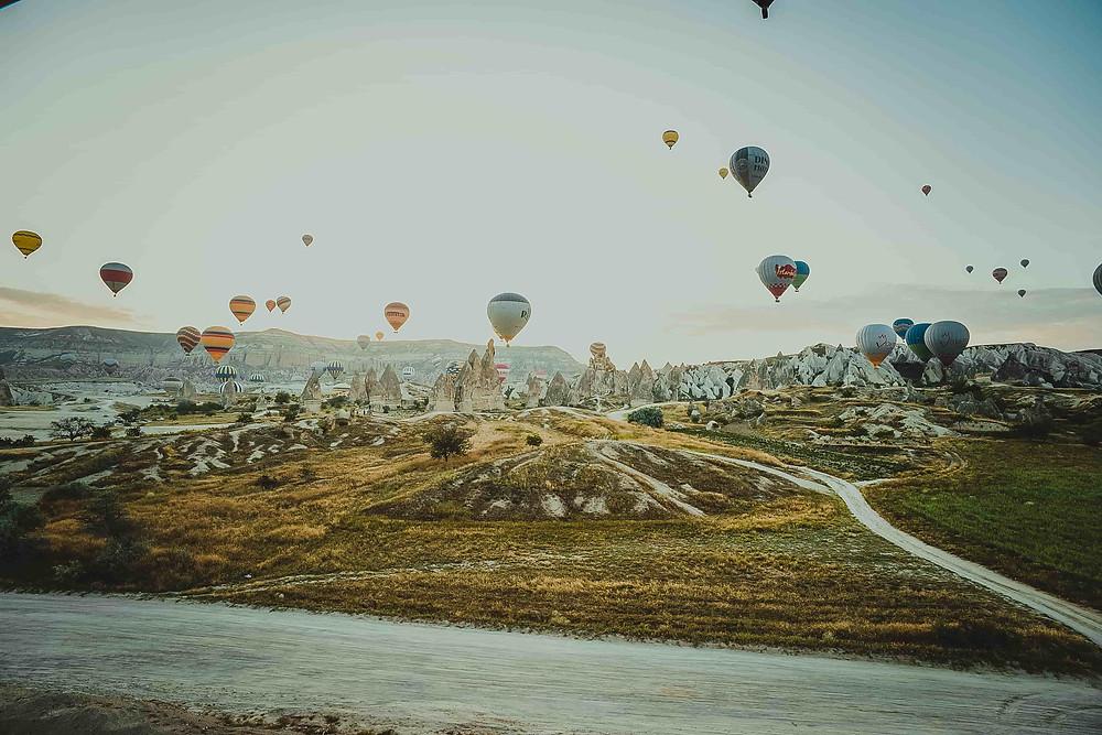 Wedding photoshoot destination: Cappadocia landscape with hot air balloons in the backdrop