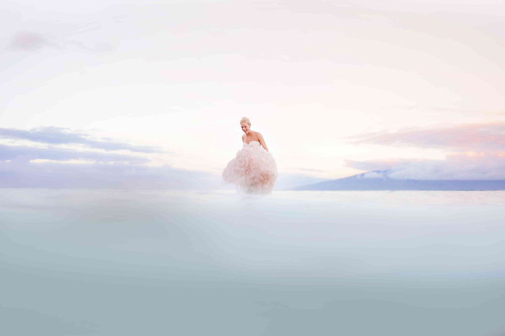 Pre Wedding Photoshoot: Bride in her light pink gown in the sea