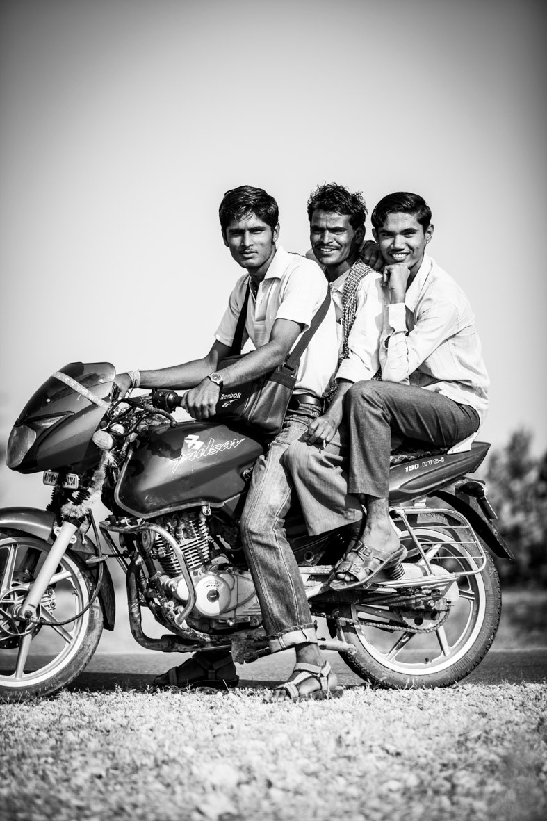 Three men | bike | India