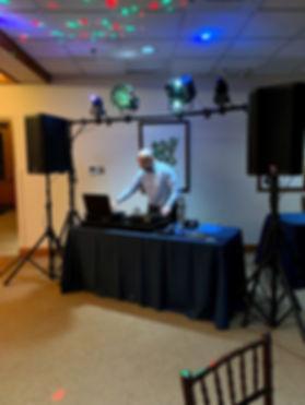 Jason Govekar at work with DJ equipment and lights