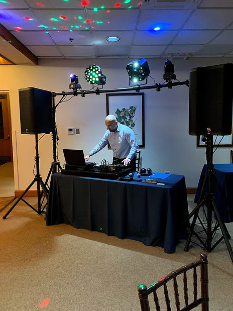 Jason Govekar at work with DJ equipment and lights