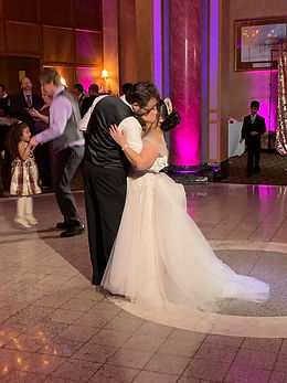 Happy newlyweds dancing to the first dance