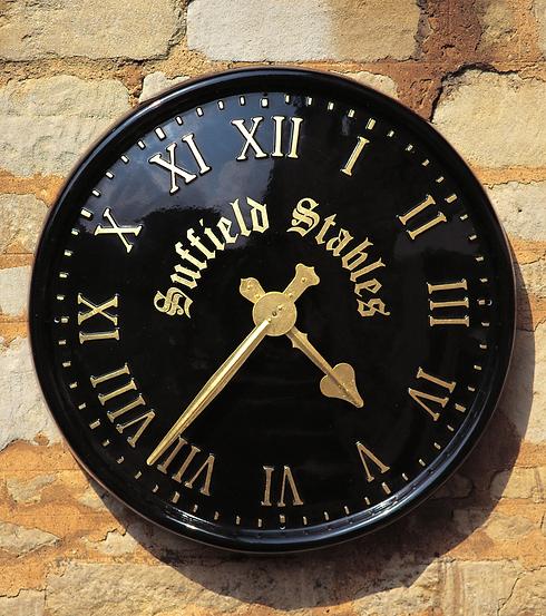Sign written large exterior clocks