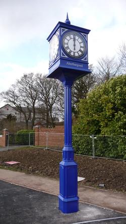 Pillar clock with name of town