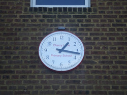 Clock with school name on dial