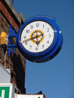 Drum clock with logo and signage