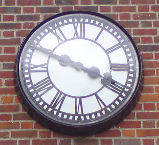 Bezel clock with protective cover