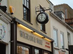 Drum clock above a shop